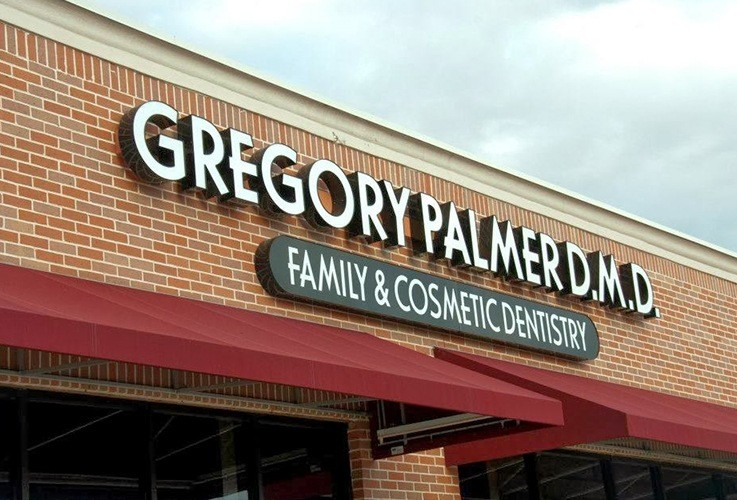Gregory Palmer, DMD & Associates Family & Cosmeitc Dentistry sign on building