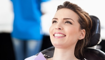 Woman smiling during preventive dentistry checkup